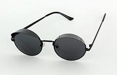 Stor John Lennon solbrille.